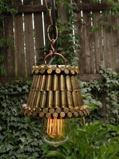 Another bullet lamp I made. I soldered together 104 bullet casings, 46 Mag casings, and 10 cal casings. Also for sale over at Etsy. Bullet Casing Crafts, Bullet Casing Jewelry, Bullet Crafts, Bullet Necklace, Old Bullet, Bullet Art, Bullet Shell, Shotgun Shell Art, Shotgun Shell Crafts