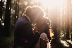 The adoring way this groom cradles his bride's face as he goes in for the big one is too sweet. Brilliant sunshine highlights this elopement kiss at just the right angle, bathing the couple in an almost mystical light.