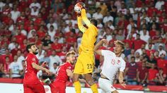 Goalkeeper Volkan Babacan (2nd R) of Turkey in action during their UEFA EURO 2016 qualifier against Netherlands