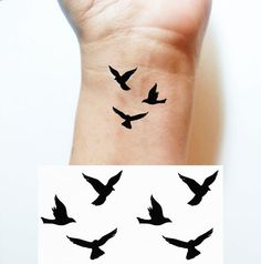 Temporary TATTOO Body Art 3 Birds In Flight Tattoo size: Small: 1 1/2 x 1 3/8 Medium: 2 3/8 x 2 1/8 Large: 3 3/8 x 3 1/8 Set of 2 tattoos