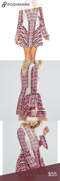 Free people tegan dress dress Woven fabric Printed design Round neck Cut-out detail Flared sleeves Regular fit - true to size Machine wash 100% Rayon Perfect Valentine's dress!! Free People Dresses Mini
