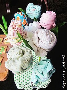 Baby clothes bouquet - perfect for baby shower via http://confetticookies.blogspot.com