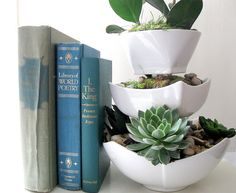 would love to make for bedroom/bathroom; says it is made w/ dollar store finds (wish my dollar store had nice containers/bowls like these!)... will have to keep looking, beautiful, simple
