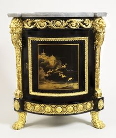 1772 French Black lacquer corner cabinet at the Royal Collection, UK - This cabinet was designed to fit into the corner of a room, as evidenced by its having three feet rather than four; the entire cabinet would have the shape of a curved triangle.  The Japanese lacquer panel on the front dates from the 1640s and was split in half and then incorporated into the design when this cabinet was made along with its partner (which holds the other half of the lacquer panel).