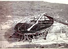 One of the so-called Nemi ships, shortly after being recovered from Lake Nemi. The workmen in the foreground give an idea of scale. They were built for Emperor Caligula in the 1st century CE at Lake Nemi. Both ships were destroyed during WW2.