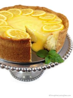 Spectacular Lemon Bar Cheesecake. Deliciously sweet and crunchy crust creamy…