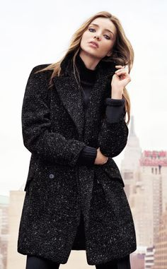 MANGO Winter 2013 from Miranda Kerr's Top Modeling Moments The Australian beauty bundled up in a tweed coat and chunky knit turtleneck sweater for the fashion retailer.
