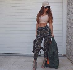 A sexy military chic outfit idea it's all about fashion trends with this look. This is how you wear open toe booties with baggy camo pants and a bomber jacket