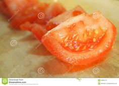 Cutted tomatoes on a desk