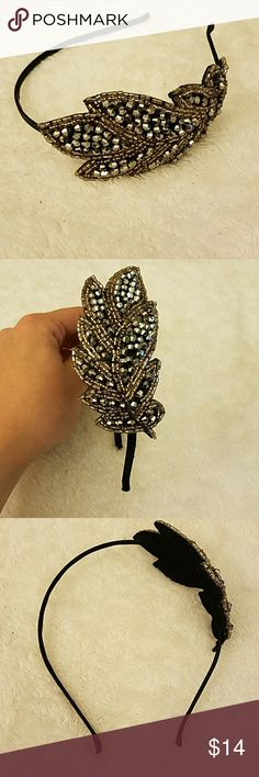 Ann Taylor Beaded Headband Very cute beaded headband! The main part is black, small beads are a metallic gold, and bigger round beads are a granite/charcoal.  Feel free to ask me questions, and please see my other listings! Bundle discount available! Ann Taylor Accessories Hair Accessories