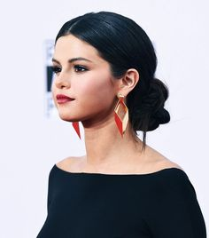 Selena Gomez's big, braided bun and sleek center part are so stunning