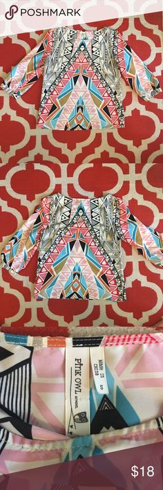 Aztec Print Top This top is so much fun! It is gently worn and in EUC! So many fun and beautiful colors. The last photo shows that the sleeves are cuffed. It is made of Polyester and washes and wears so well. Bought full price from a local boutique. All my clothing comes from a pet free and smoke free home 🏡 Please make an offer and ask questions if interested! Pink Owl Tops