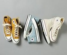 Converse. Ok I'd buy the yellow ones even though everyone has converse now