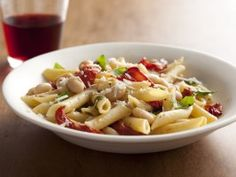 """PENNE WITH ROASTED TOMATOES, GARLIC, AND WHITE BEANS: ~ From: """"Cooking ChannelTV.Com"""" ~ Recipe Courtesy of: """"Ellie Krieger"""". ~ Prep.Time: 15 min; Inactive Prep: 0 min; Cooking time: 50 min; Level: Easy; Yield: 4 ( 1-1/2 cup servings)"""