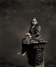 """Momento Mori, better known as Victorian Death photos, are a way to memorialize the deceased, especially children. Many times this was the only photographic evidence of the child. Sometimes the photographs would take place days after the death and the photographer would """"pose"""" the subject in order to make them seem alive but many times the photo was taken when the child was in the casket, being held by their parents or lying repose on a bed or sofa. I think this photos are hauntingly beautiful."""