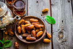 Dates are high in calories, carbs and naturally occurring sugars, making the dried fruit a good pre-workout energy source for active older adults.