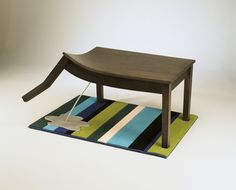 Creative table design beats your dog to the punch... then urinates it all over your carpet. Made with western maple and aluminum, this is just one of many creative designs from Straight Line