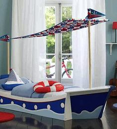 toddler boat bed ~ Low to the floor and colorfully painted, this boat bed works for preschool age.