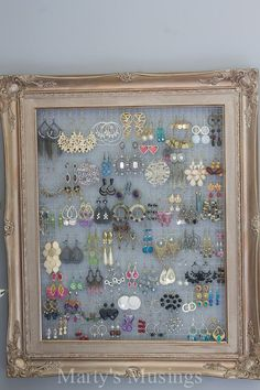 Blogger Marty's Musings shows you how to decorate a bedroom for practically nothing using yard sale finds, thrifted decor and DIY projects with creativity. This easy DIY frame for jewelry is easy and inexpensive with a $1 yard sale frame and some chicken wire!