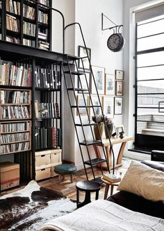 black metal library ladder in front of black metal book cases / sfgirlbybay