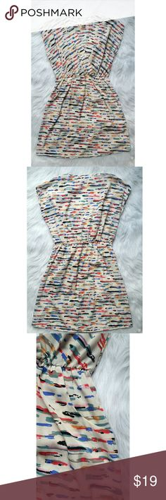 "Francesca's Dress V neck Francesca's shift dress. Ivory with multicolor pattern throughout. Cap sleeve. Elastic waistband. Two front pockets. Beautiful dress. Measures: Bust 19.5"" -- Shoulder 17"" -- Length 34.5"" -- Francesca's Collections Dresses"