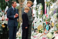 Charles, William and Harry viewing floral tributes to Diana.: [object Object]