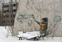 Graffiti is seen on a wall of one of the buildings in the ghost city of Pripyat, near Chernobyl nuclear power plant on February 22, 2011. (SERGEI SUPINSKY/AFP/Getty Images)