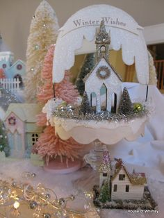 """House of Whimsy: I love this one! It appears to be on a """"cake stand"""" type of structure with a banner attached over the top- darling!"""