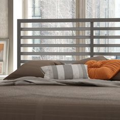 World Travel room - Headboard. Pure and defined lines set the pace for your trendy bedroom. The Theodore bed in a glossy grey finish features a contemporary design constructed of top-quality solid steel. The bed includes a headboard and a footboard to complete the look.