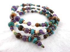 Gemstone and copper wrap around memory wire bracelet.