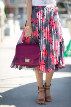 Floral, pleated midi skirt is a spring staple in our opinion.