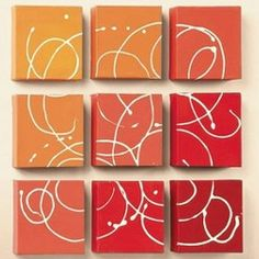 Paint 9 mini canvases in coordinating colors, then put them tightly together in a square. Next, use a squeeze bottle filled with white paint to swirl a fun, abstract design. Hang the pictures slightly apart as shown.
