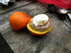Start with a tube of ready-to-bake cinnamon roll from any supermarket. Take an orange, cut it in half, then scoop out ( and eat ) all the fruit. Place a cinnamon roll from the tube into the orange rine, then wrap it in tin foil. Place it on a camp fire for 10-20 minutes and you're all set!