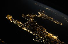 """The beauty of Italy, on a clear summer night, stretching out into the Mediterranean Sea"