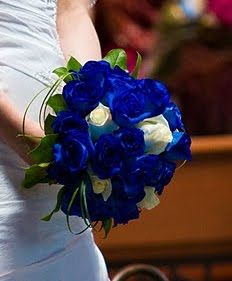 We are blown away by this Sodalite Blue and white rose bouquet that is simply stunning.
