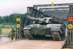 A Challenger 1 MBT crossing over a Baily Bridge built by 35 Engineer Regiment