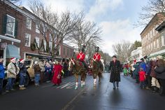 Woodstock's annual Winter Wassail Parade features horses and riders in traditional costumes.