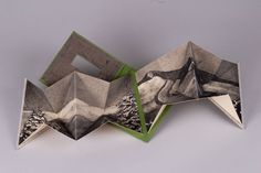 """Artist: Rachel Mauser Title: I Went to the Mountains, but They Were Not There Medium: accordion book with intaglio Size: 4 ¼""""x4 ¼"""" Location: Murray, KY"""