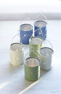 DIY Ideas With Old Tin Cans - DIY Tin Can Lanterns - Rustic Farmhouse Decor Tutorials and Projects Made With An Old Tin Can - Easy Vintage Shelving, Wall Art, Picture Frames and Home Decor for Kitchen, Living Room and Bathroom - Creative Country Crafts, Craft Room Storage, Silverware Holder, Rustic Wall Art and Accessories to Make and Sell http://diyjoy.com/diy-projects-tin-cans