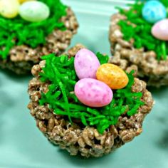 Cocoa Krispies Bird's Nest Treats - Cute Bird's Nest treats made with Cocoa Krispies cereal! Shredded coconut is mixed with green food coloring to look like grass, then they are topped with Brach's Speckled Jelly Bird Eggs!