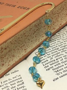Gold and turquoise beaded bookmark Faceted Glass, Glass Beads, Turquoise Beads, Turquoise Bracelet, Beaded Bookmarks, Organza Gift Bags, Heart Of Gold, Floral Motif, Heart Charm