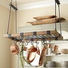 """Our Arturo Pot Rack serves up rustic good looks and beautifully engineered storage for the serious cook. The solid oak frame with riveted black iron strapping and eight """"S"""" hooks holds up to 220 lbs. Farmhouse Pot Racks, Rustic Pot Racks, Pot Rack Hanging, Hanging Pots, Pot Hanger Kitchen, Kitchen Island Pot Rack, Industrial Pot Racks, Moraira, Küchen Design"""