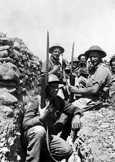 A group of British soldiers in a trench with fixed bayonets, Crete, Greece, late May 1941.