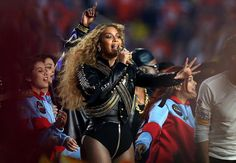 Queen Bey honors the King of Pop. If you thought Beyoncé's black-and-gold Super Bowl ensemble was an homage to Michael Jackson's 1993 halftime show outfit, y...