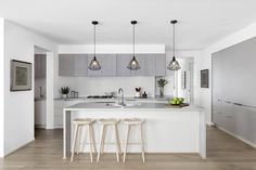 The Barcelona 32 by Boutique Homes Vic #weeklyhometrends #boutiquehomes #newhome #newbuild #displayhome #kitcheninspo #interiors #design #styling #pendantlights #kitchenstools #timber #greytones #calmingcolourpalette http://www.boutiquehomes.com.au/home-design-group/barcelona