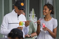 ASSOCIATED PRESS President Barack Obama eats shave ice with daughter Malia Obama at Island Snow, Thursday, Jan. 1, 2015, in Kailua, in Hawaii during the Obama family vacation.