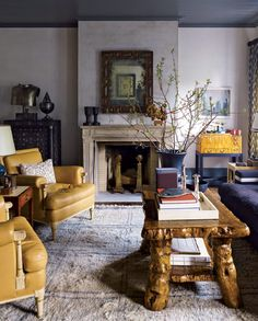 """Steven Gambrel ~ The root coffee table may look rustic, but Gambrel insists it's perfect for a sophisticated, urban apartment. """"It's rare and refined,"""" he says. """"An ancient piece of wood that's been discovered and preserved."""""""