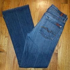 7 for all mankind bootcut jeans 7 for all mankind jeans in medium blue wash size 28. Inseam 28.75 inches. Front rise 8 inches. Minor hem and pocket wear. See pic. Excellent condition. 7 for all Mankind Jeans Boot Cut