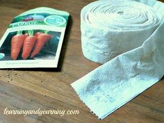 """Make your own seed tape. """"Seed tape is a great product for planting that has seeds embedded right into it. It's perfect for planting tiny seeds like carrot that are difficult to space in the garden. The """"tape"""" is made of bio-degradable paper which is planted directly into your garden."""""""