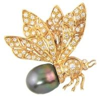 A bee pin from the La Boutique collection by Bellarri contains 0.83 ct. of round diamonds and one black Tahitian Pearl set...
